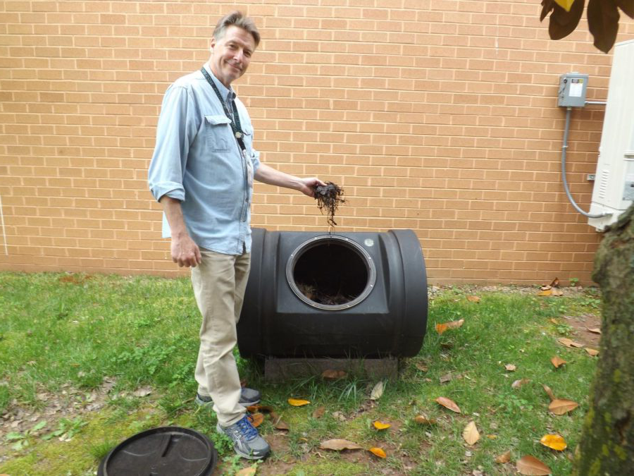Mr. Treakle helps to create organic fertilizer for the Courtyard Garden on May 8. He recently won the FCPS teacher of the month award.