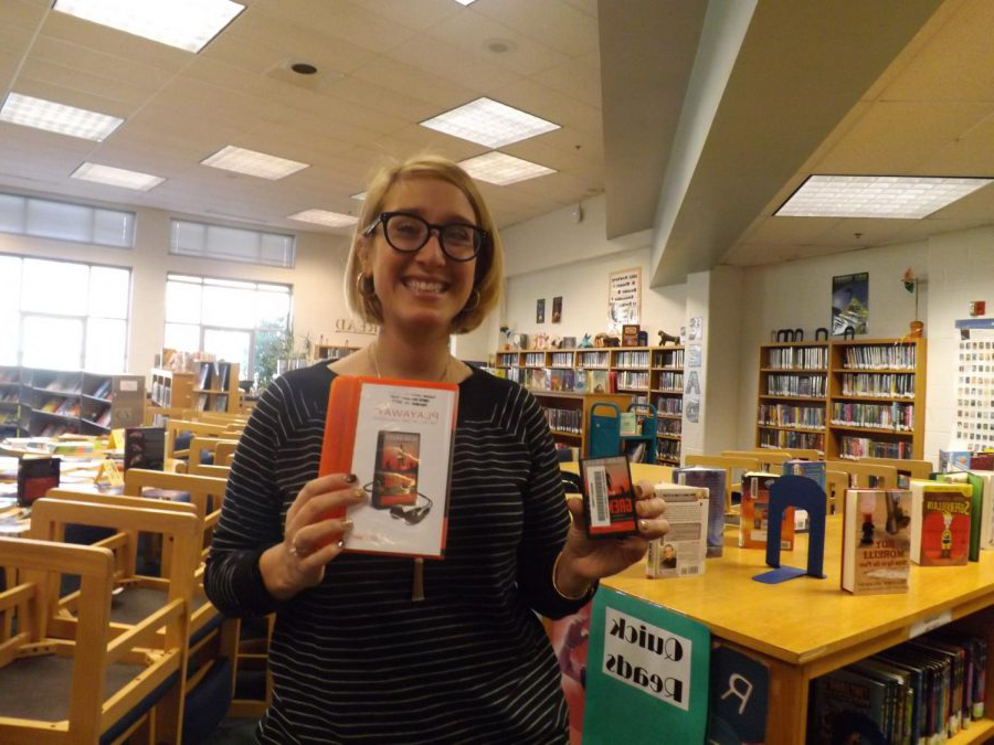 "One of Carson's librarians, Ms. Elizabeth Donovan, holds the new library copy of the audiobook of ""Grenade,"